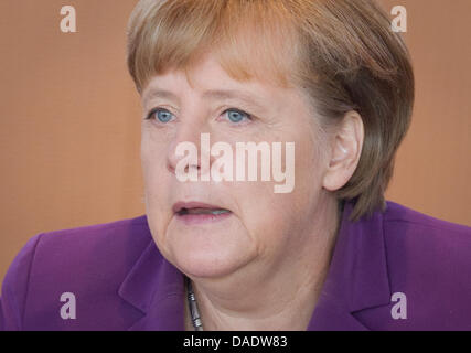 German Chancellor Angela Merkel (CDU) sits at the conference table awaiting the start of  the federal cabinet meeting - Stock Photo
