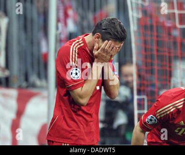 Bayern Munich's Mario Gomez cheers after scoring the 2-0 goal during the first half of the Champions League group - Stock Photo