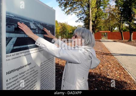 Andrea Kaltofen, managing director of Esterwegen Memorial, explains the position of the former prisoner barracks - Stock Photo