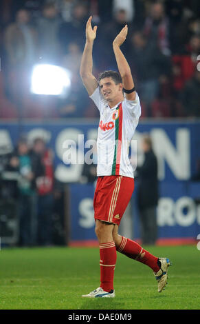 Munich's Mario Gomez cheers about the victory after the German Bundesliga match FC Augsburg vs FC Bayern Munich - Stock Photo