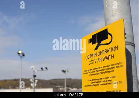 Sign warning of closed circuit television, cctv, security cameras recording in a privately run carpark, Aberystwyth, - Stock Photo