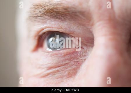 Senior man's eye, close up - Stock Photo