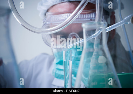 Scientist using pipette, close up - Stock Photo