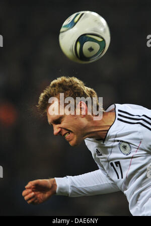 Germany's Per Mertesacker heads the ball during the international friendly soccer match Germany vs Netherlands at - Stock Photo