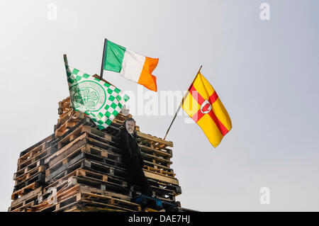 Newtownabbey, Northern Ireland. 11th July 2013. An effigy of Gerry Adams is placed at the top of Ballyduff bonfire - Stock Photo