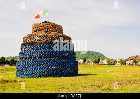 Newtownabbey, Northern Ireland. 11th July 2013. Rathcoole bonfire with an Irish Tricolour on top to be burned Credit: - Stock Photo