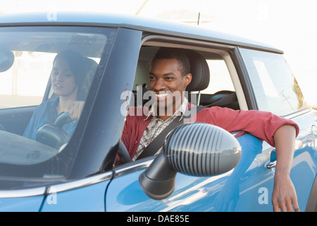 Young couple in car - Stock Photo