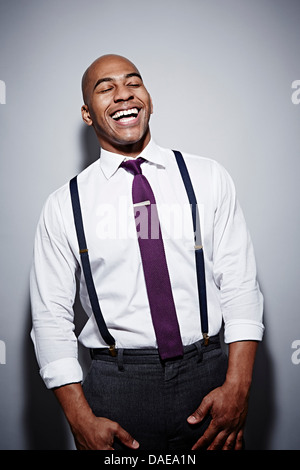 Studio portrait of businessman laughing - Stock Photo