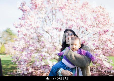 Grandmother and grandchild in garden - Stock Photo