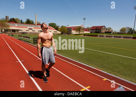 Young athlete taking a break after training - Stock Photo