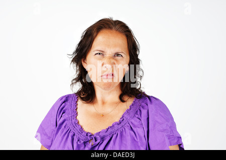 Grumpy, irritated and upset middle aged woman - Stock Photo