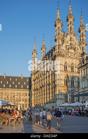 Tourists at pavement cafés in front of the Gothic town hall at the Grote Markt / Main Market square, Leuven / Louvain, - Stock Photo