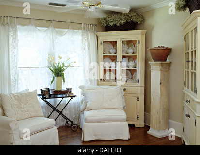 White Loose Covers On Chairs In Front Of Window With Lace Curtains Cottage Living Room