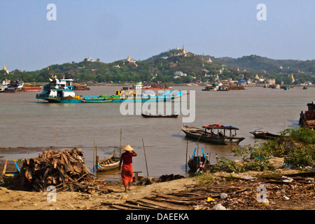 boat traffic on the Irrawaddy River with Sagaing hill behind, Burma, Mandalay - Stock Photo