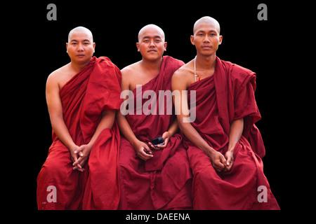 three buddhistic monks sitting next to each other, Burma, Pyin U Lwin - Stock Photo