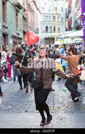 woman dancing in the street, carnaval in las palmas, gran canaria - Stock Photo