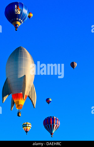 Distance shot of hot air balloons against blue sky at Spirit of Boise Balloon Classic in 2011 - Stock Photo