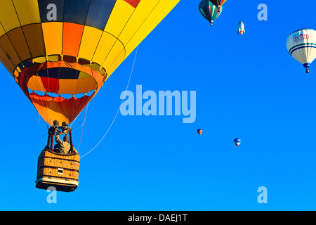 Closeup on colorful hot air balloons with other balloons in background at Spirit of Boise Balloon Classic in 2011 - Stock Photo