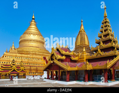 The GILDED SHWEZIGON PAGODA or PAYA was completed in 1102 AD by King Kyansittha, Burma, Bagan - Stock Photo
