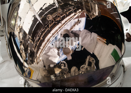 European Space Agency astronaut Luca Parmitano takes a self portrait of his reflective helmet visor with the earth - Stock Photo