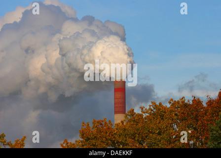 heavily smoking factory chimney, Germany, North Rhine-Westphalia, Ruhr Area - Stock Photo