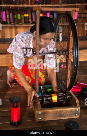 The weaving of LOTUS SILK fabric from the stalks of the lotus plant is a local industry of INLE LAKE, Burma, Nyaungshwe - Stock Photo