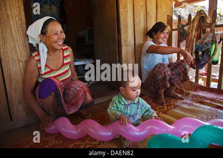 three generations share a house, Burma, Kengtung, Kyaingtong - Stock Photo