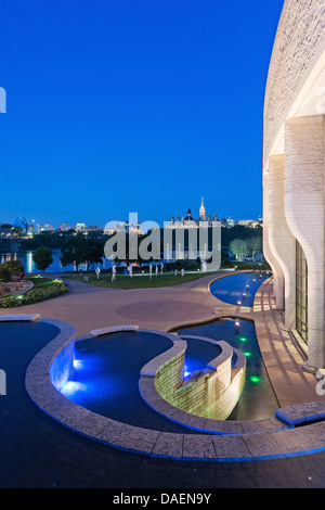 Ottawa skyline and river viewed from the Museum of Civilizations at the blue hour - Stock Photo
