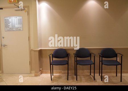 Miami Beach Florida Mount Sinai Medical Center centre hospital doctor's office waiting room chairs sign hours - Stock Photo
