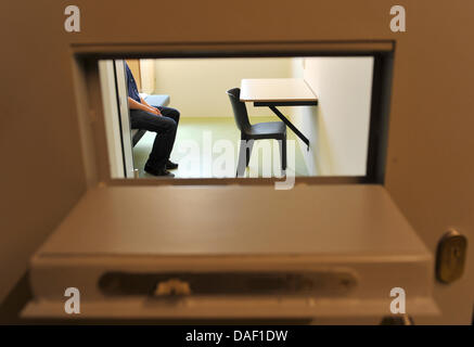 dpa FILE) - An archive picture, dated 22 May 2009, shows an illustration of a man sitting in a solitary confinement - Stock Photo
