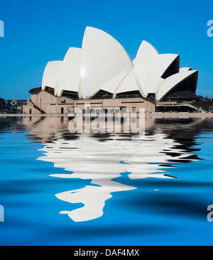View of Sydney Opera House with reflection in water  in Australia - Stock Photo