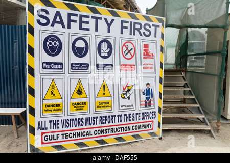 Signboard at construction site in Dubai with safety rules and regulations - Stock Photo