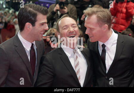 British actor Paul Bettany (L-R), US actor Kevin Spacey and US director J.C. Chandor arrive for the premiere of - Stock Photo
