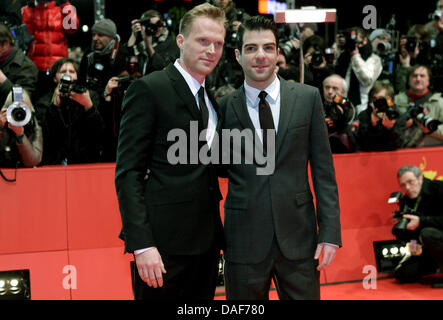 British actor Paul Bettany (L) and US actor Zachary Quinto arrive for the premiere of the film 'Margin Call' during - Stock Photo