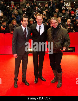 British actors Jeremy Irons (R), Paul Bettany (C) and US actor Zachary Quinto arrive for the premiere of movie 'MarginCall' - Stock Photo