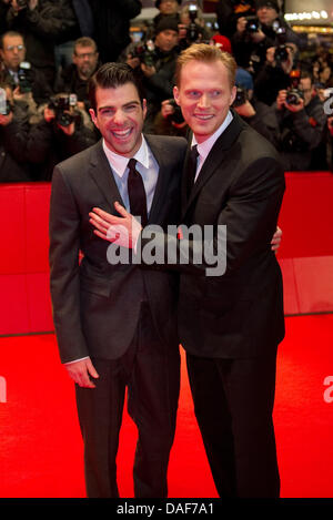 US actor Zachary Quinto (L) and British actor Paul Bettany arrive for the premiere of movie 'Margin Call' during - Stock Photo