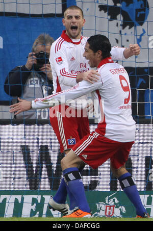 Hamburg's goal scorer Jose Paolo Guerrero (R) cheers fter his 2-0 goal with team-mate Mladen Petric during the Bundesliga - Stock Photo