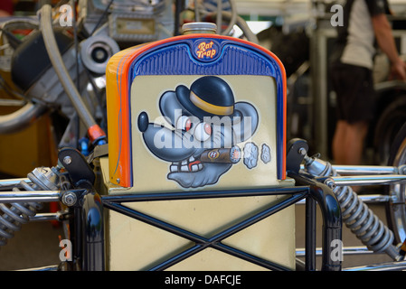 Detail showing the front of a dragster drag racing car that has a character of a rat wearing a bowler hat and smoking - Stock Photo