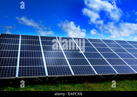 Solar farm with large solar panels in an array, France, Europe - Stock Photo