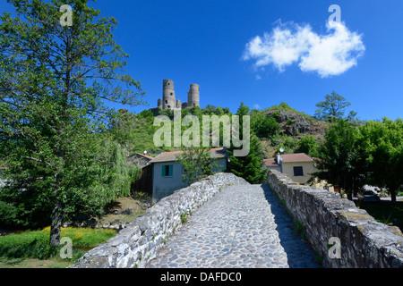 Old stone bridge in front of Château de Domeyrat castle, Domeyrat, Haute-Loire, Auvergne, France, Europe - Stock Photo