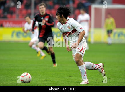 Stuttgart's Shinji Okazaki runs with the ball during the Bundesliga soccer match between Bayer Leverkusen and VfB - Stock Photo