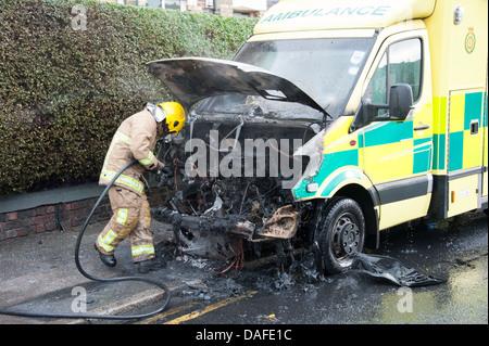 Ambulance engine compartment on fire UK - Stock Photo