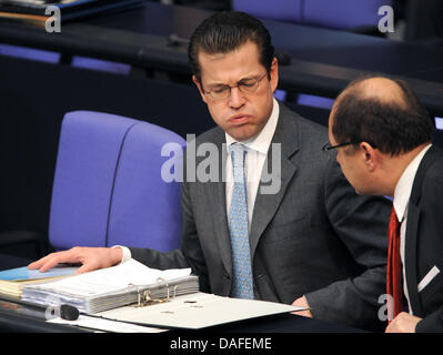 German Minister of Defence Karl-Theodor zu Guttenberg is pictured during a question time of the German Bundestag - Stock Photo