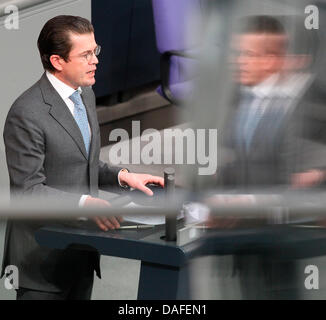 German Minister of Defence Karl-Theodor zu Guttenberg speaks during a question time of the German Bundestag in Berlin, - Stock Photo