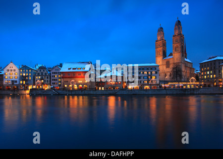 old town, Limmatquai with Guild houses and Grossmuenster, Switzerland, Zurich - Stock Photo