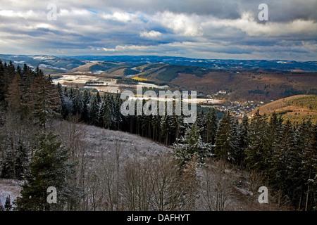 view of Sauerland an village Bilstein from lookout Hohe Bracht in winter, Germany, North Rhine-Westphalia, Sauerland, - Stock Photo