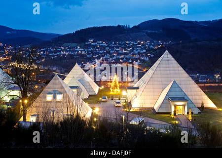 illuminated Sauerland pyramids with village of Meggen in the evening, Germany, North Rhine-Westphalia, Sauerland, - Stock Photo