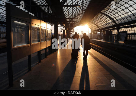 Two people wait for a train that would not come due to token strikes in Berlin Spandau, Germany, 22 February 2011. - Stock Photo