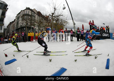 US-American Kikkan Randall (C) races in the team sprint of the Cross-country skiing World Cup in Duesseldorf, Germany, - Stock Photo