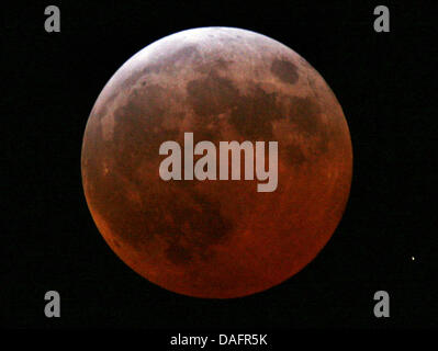 FILE - An archive picture dated 04 March  2007 shows the moon during a total lunar eclipse in Karslruhe, Germany. - Stock Photo